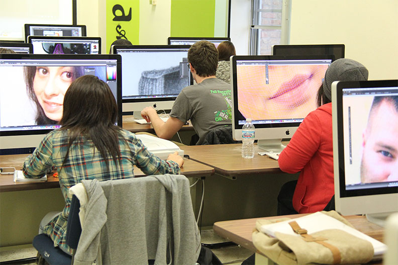 Fine art majors work in a computer lab as part of the bachelor of fine art program at Elmhurst College.