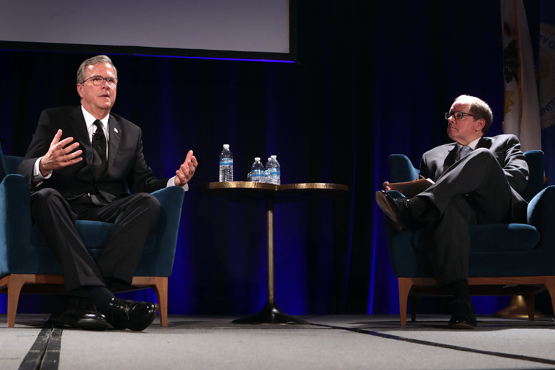 Governor Jeb Bush talks with Chicago Tribune Publisher Bruce Dold at the 11th Annual Elmhurst College Governmental Forum