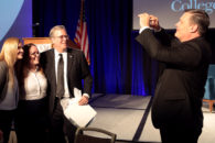 President VanAken takes a photo of Governor Jeb Bush with attendees at the 11th Annual Elmhurst College Governmental Forum