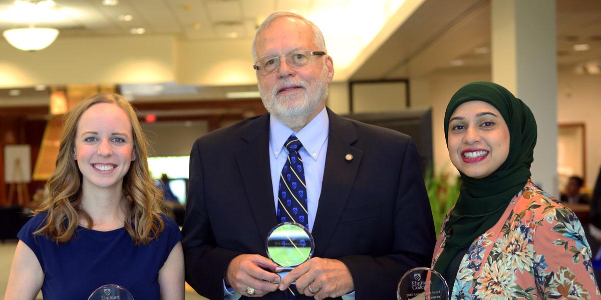2018 Alumni Merit Award honorees Emily Ann Davis, Harold Edward Brueseke and Reema Syeda Kamran pose with their awards.