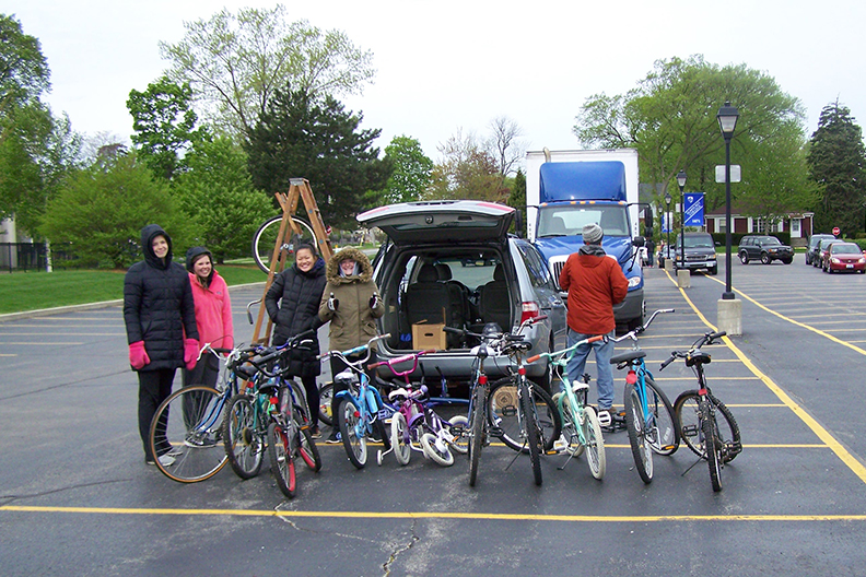 Elmhurst College Recycling Extravaganza participants pose with used bikes donated during last year's event.