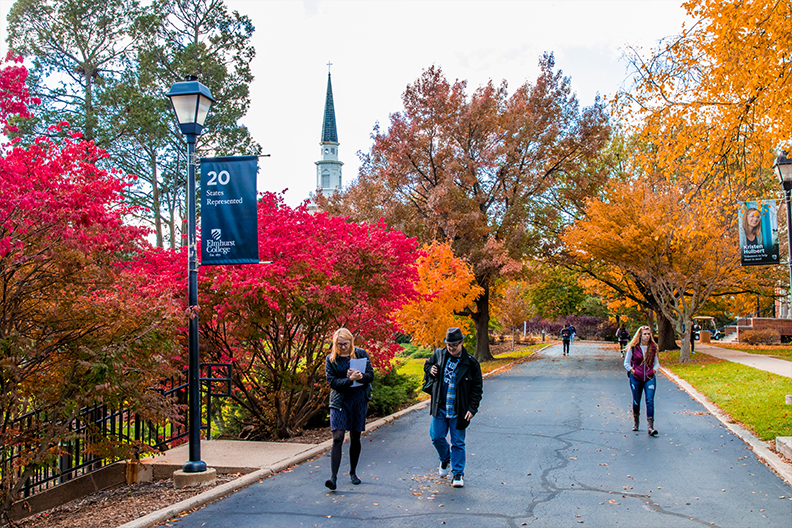 A photo of students walking on Elmhurst College's arboretum campus.