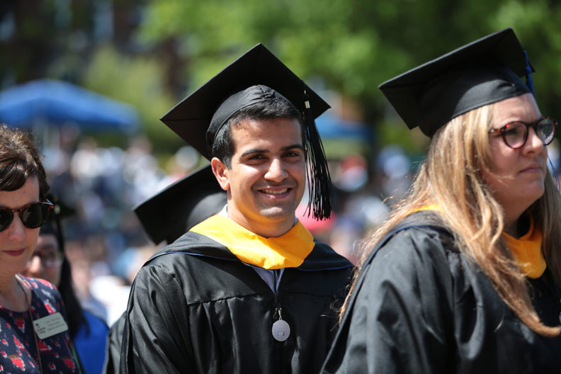 A student waits in line during Elmhurst College's commencement ceremony.