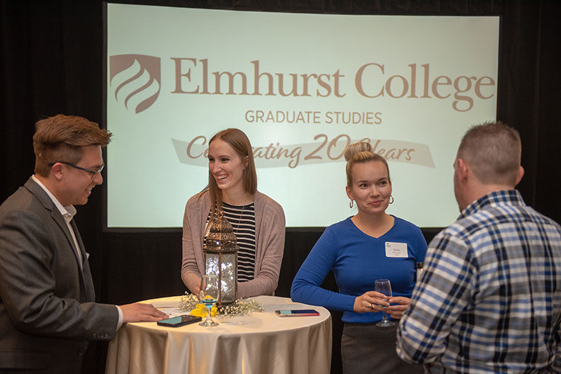 Students, alumni and friends gathered for a 20th anniversary celebration of Elmhurst College's graduate studies May 11, 2019.