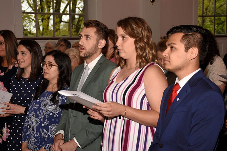 Elmhurst College Senior of the Year award finalists look on during the 2019 Founders' Honors Convocation ceremony.