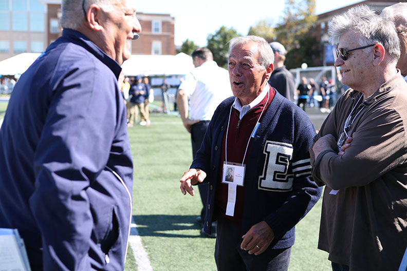 Elmhurst College alumni reconnect at the Homecoming football game.