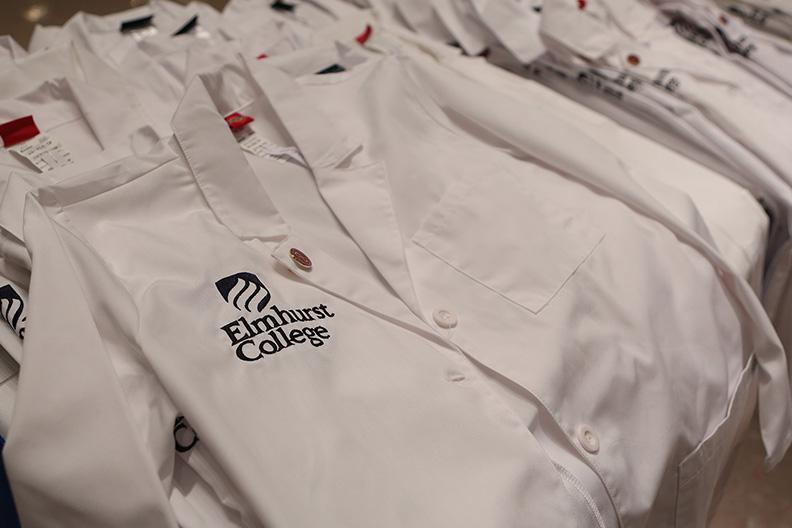 Elmhurst College-branded white coats represent Elmhurst's robust health sciences program.