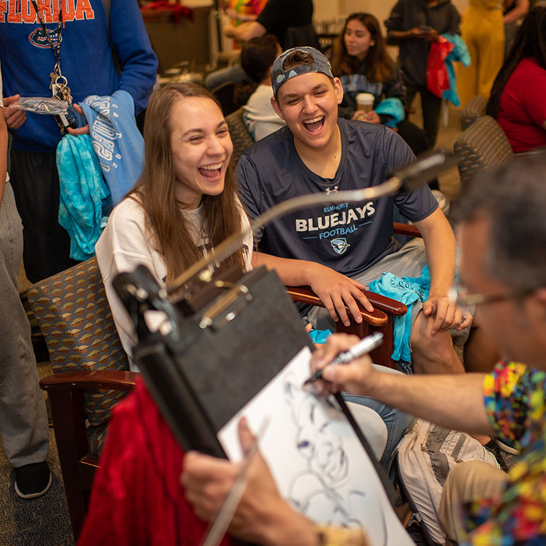 Students have their caricatures drawn during Farewell Fest at Elmhurst College.