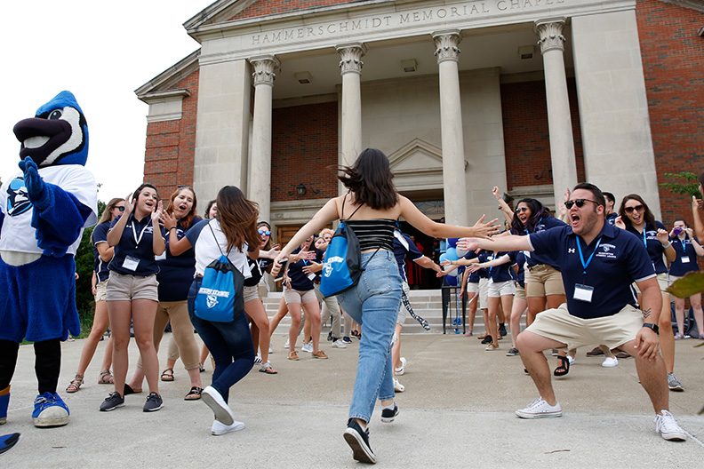 Students are greeted by their cheering peers outside Hammerschmidt Memorial Chapel during Elmhurst College's 2019 New Student Orientation.