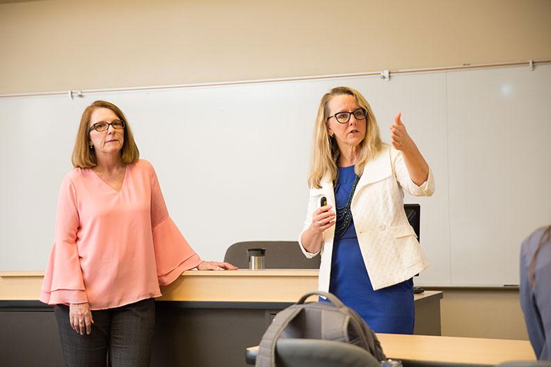 Elmhurst College professors Sherry Smoak and Soni Simpson lead a market research practicum for graduate students.
