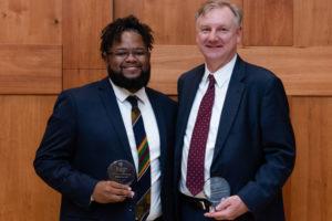Phillip Lee '14 and Richard Dabrowski '85 with their Alumni Merit Awards.