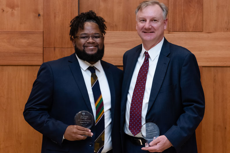 Phillip Lee '14 and Richard Dabrowski '85 with their Alumni Merit Awards.