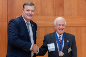 President Troy D. VanAken presenting the 2019 Founders Medal to Ralph Pechanio at the Founders Recognition Dinner.