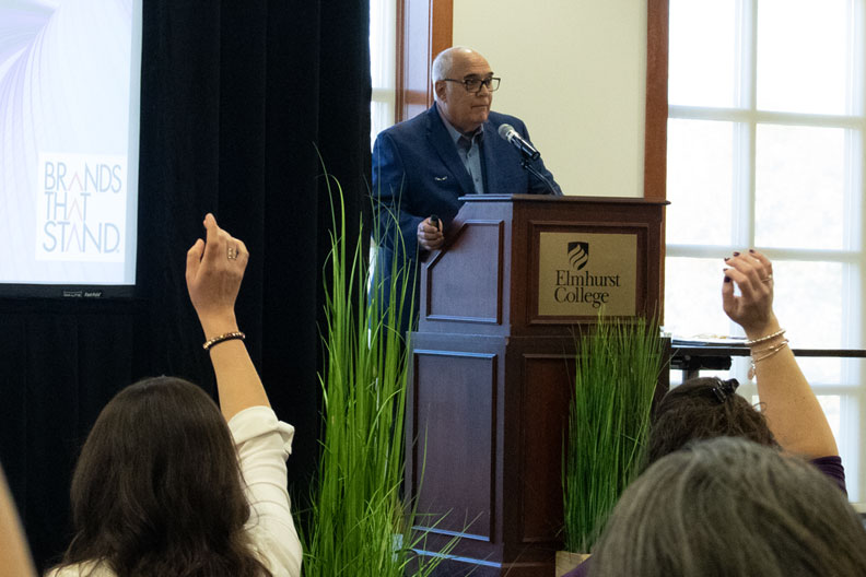 Branding expert Jim Paglia addresses the audience at his Creating Brands That Stand workshop at Elmhurst College.