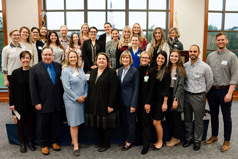 Panelists and students pose for a large group photo at the Elmhurst College Master's Entry in Nursing Practice Legislative Breakfast in October of 2019.