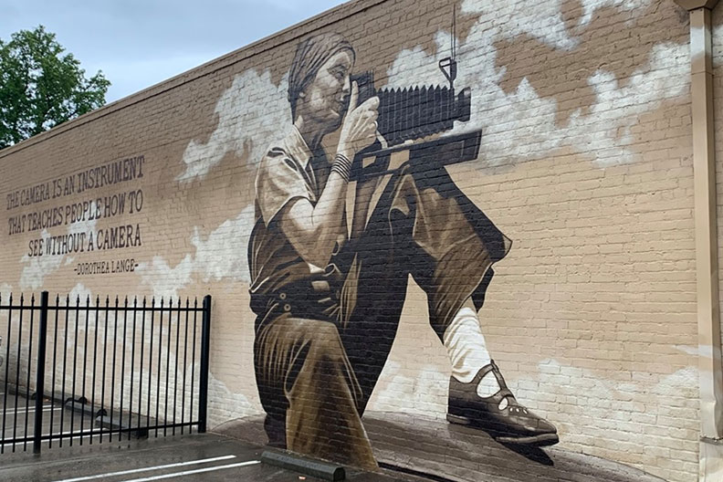 A mural painting of photographer Dorothea Lange by artist and Elmhurst College faculty member Rafael Blanco.