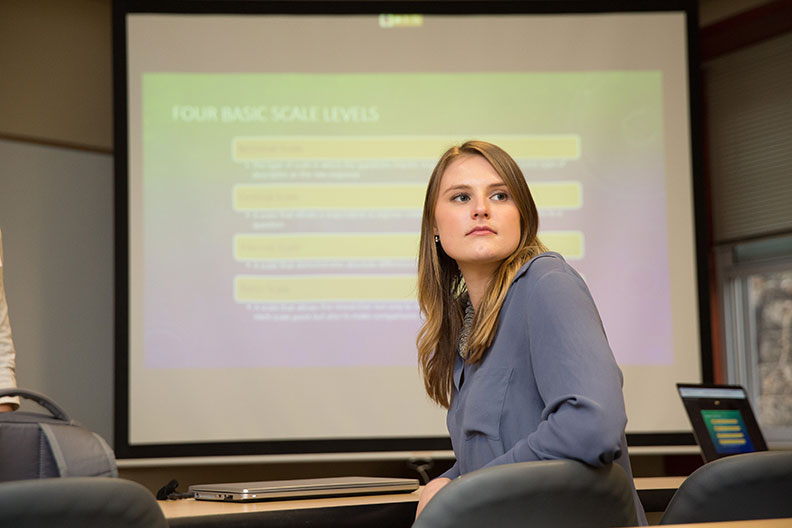 A student turns around in her chair during a graduate marketing research class at Elmhurst College.