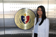 Photo of Elmhurst College student Ruba Ahmad getting her white coat at Illinois College of Optometry.