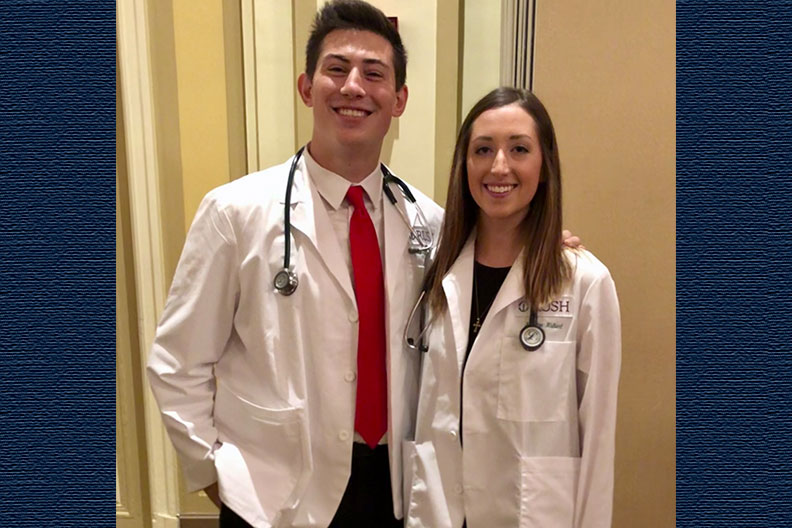 A photo of Elmhurst College students Dian Ivanov and Kristen Hulbert, who received their white coats at Rush Medical College.