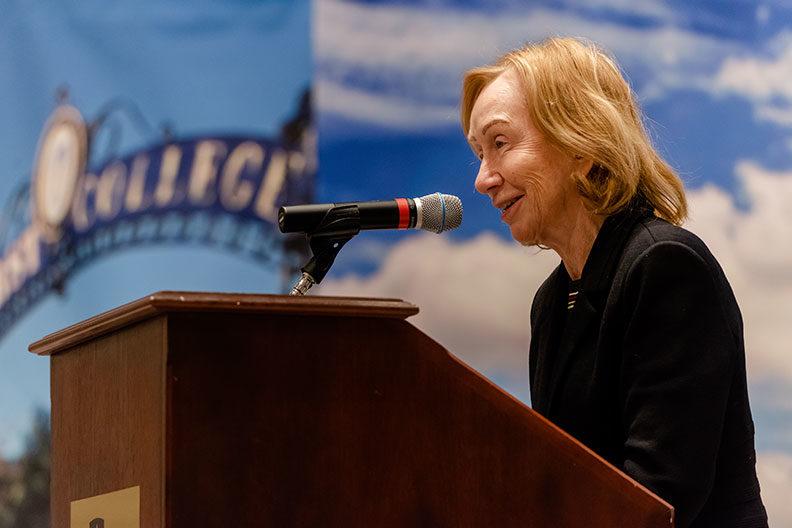 Historian and author Doris Kearns Goodwin speaks at the podium in Elmhurst College's Hammerschmidt Memorial Chapel.