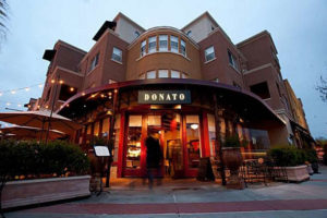 A photo of the entrance of Donato Enoteca restaurant in Redwood City, California.