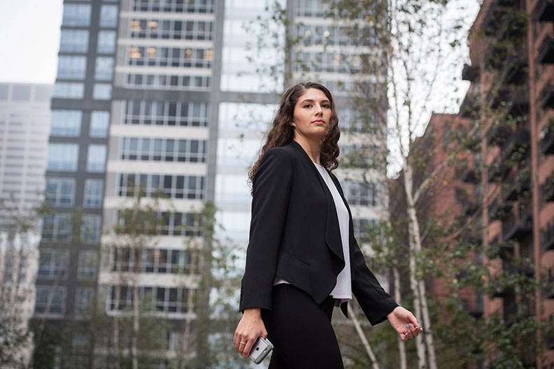 Elmhurst College student Olivia Parks walks along a street in Chicago's Loop business district.