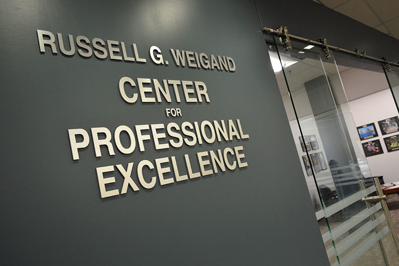 "The words ""Russell G. Weigand Center for Professional Excellence"" are shown outside the office space that houses Elmhurst College's career center."