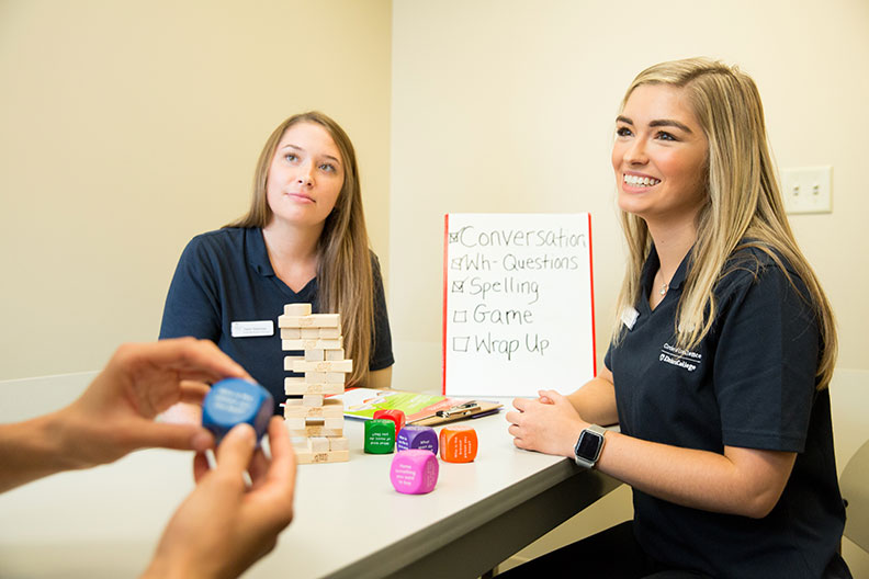 Two Elmhurst students demonstrate clinical tests.