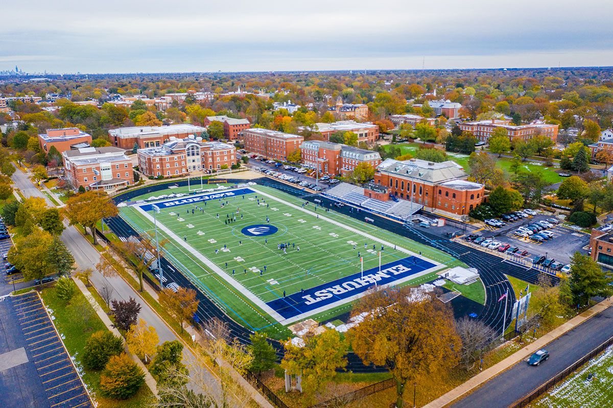 Langhorst Field, Elmhurst College's football field, is in the foreground of an aerial photograph of the campus.