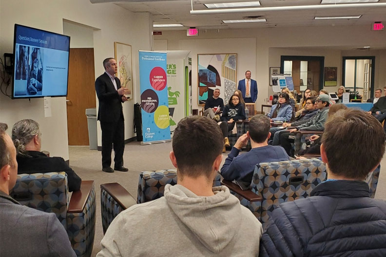 "Businessman Mark Heintz addresses students and faculty at Elmhurst College during his talk ""What it Takes to be a Successful Entrepreneur."""