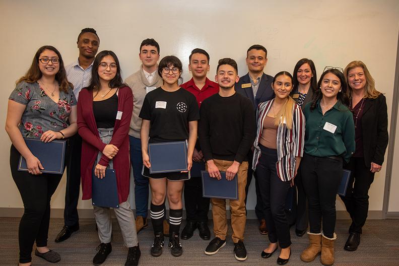 The award winners with Constance Mixon, interim vice president of academic affairs and dean of the faculty, Christine Grenier, senior director of first-year and international admission, and Adrian Dominguez, senior admission counselor.