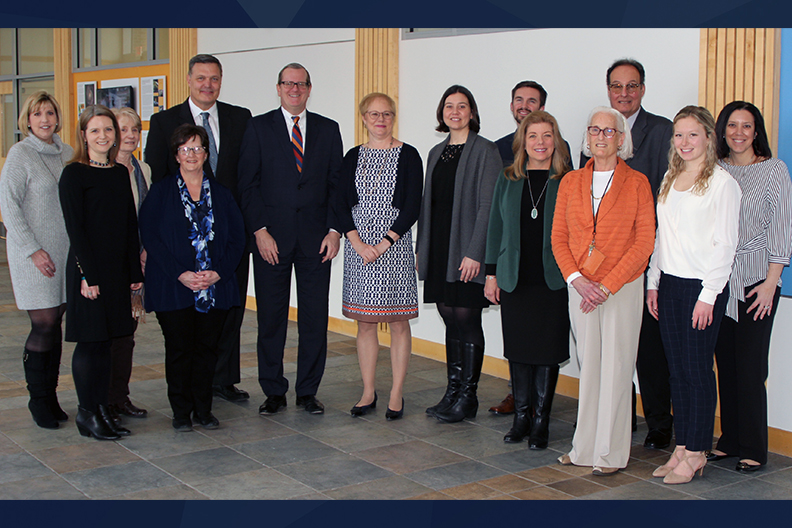Administrators and faculty from Elmhurst College and Wheaton College pose in a group photograph to mark a new partnership on a master's entry in nursing practice degree program.