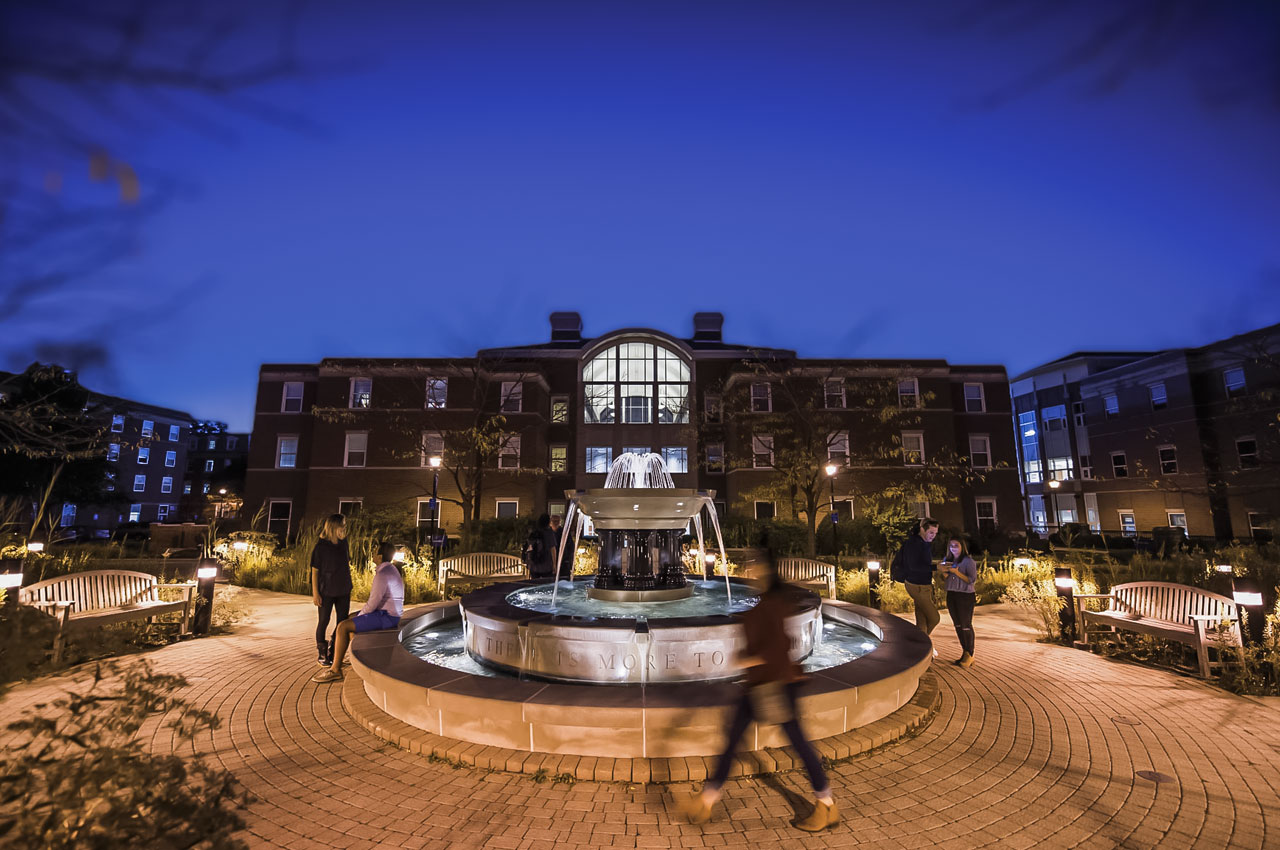 The Alumni Fountain on the Elmhurst University campus is shown at nighttime.