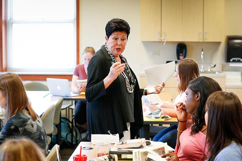 Elmhurst University education professor Therese Wehman addresses students in her classroom.