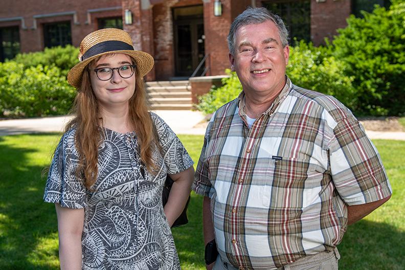 Edward and Erin Bartholomew on campus during the Elmhurst University Gates of Knowledge installation.
