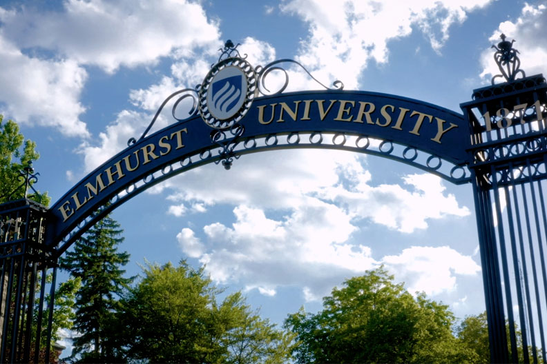 """A photo of the Elmhurst University """"Gates of Knowledge"""" at the University's East entrance."""