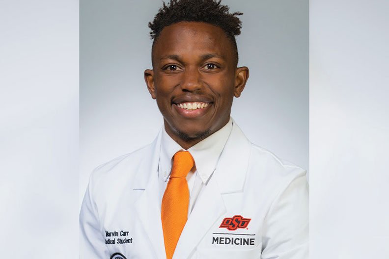 Elmhurst University alumnus Marvin Carr is pictured in his Oklahoma State University white coat.