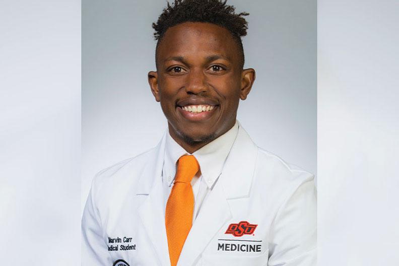 Elmhurst University alumnus Marvin Carr is pictured in his Oklahoma State University white coat.