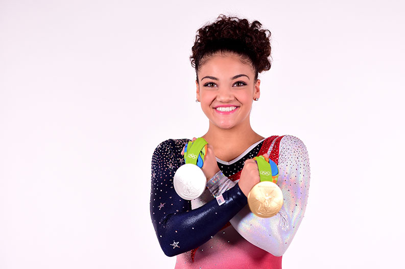 U.S. Olympic gymnast Laurie Hernandez holds the silver and gold medals she has won.