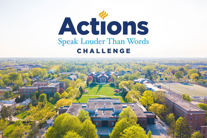 The Elmhurst University Actions Speak Louder Than Words Challenge Logo is placed on a background photo that is an aerial photograph of the campus.