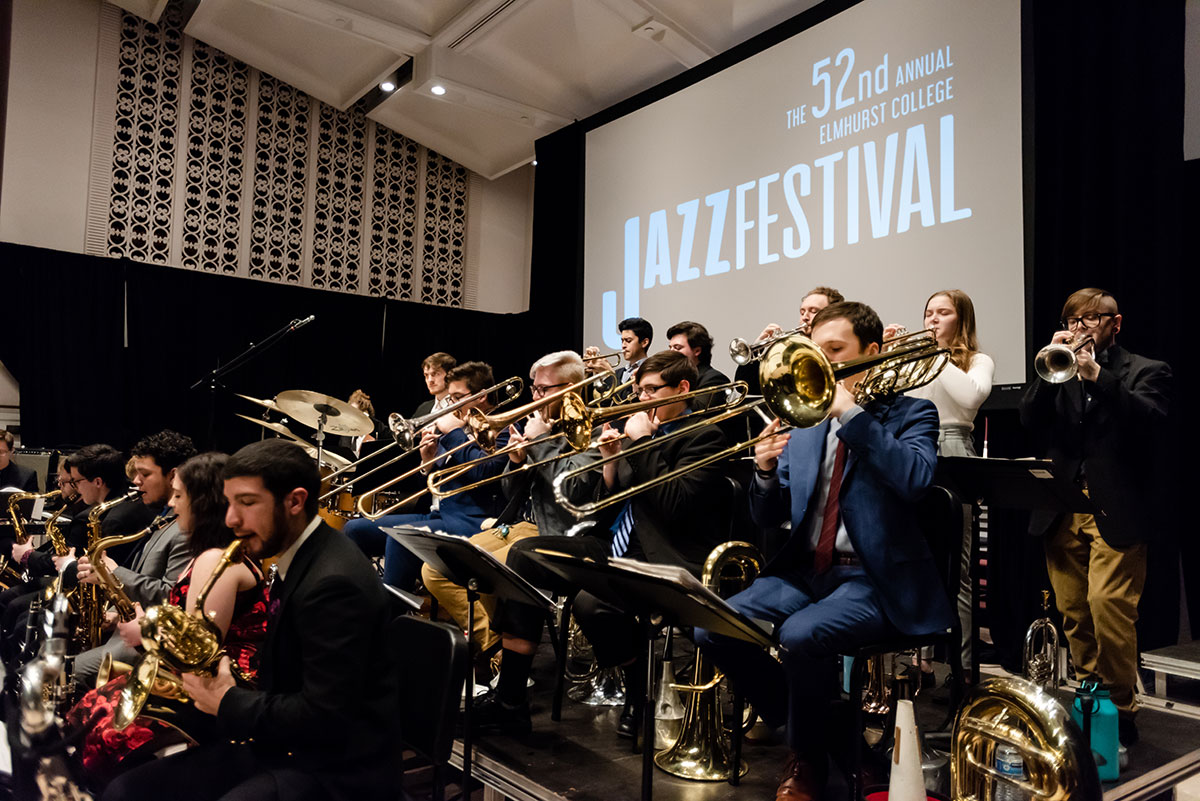 A row of trombone players is featured as students in the Elmhurst University Jazz Band perform during the University's annual Jazz Festival.
