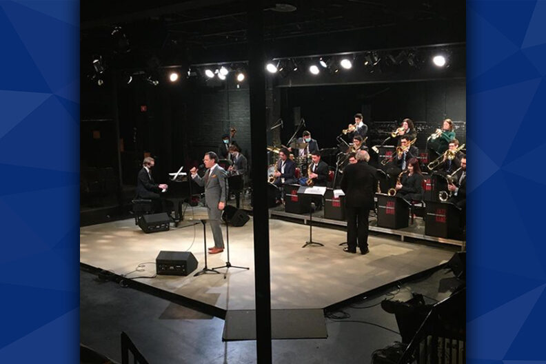 A photo of a jazz group playing on a stage.