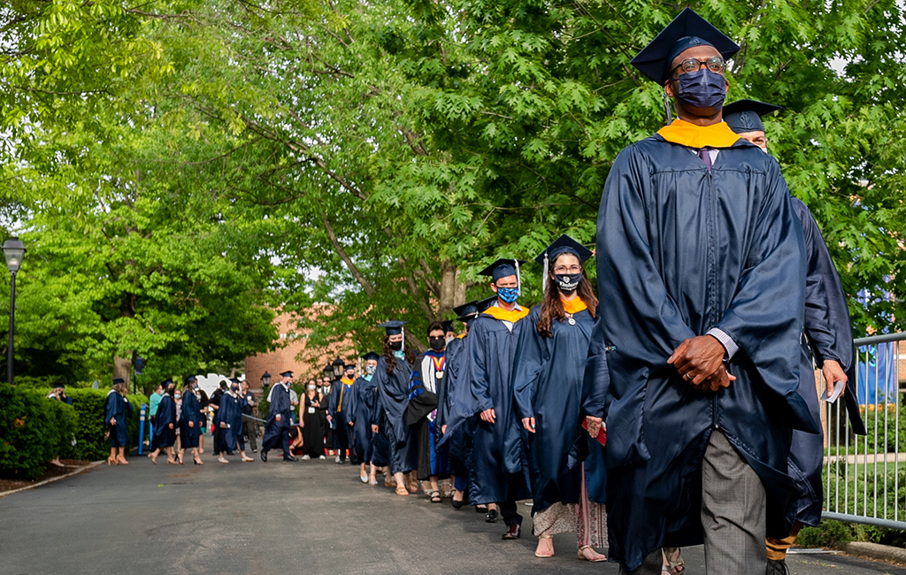 Graduate students process during the Commencement ceremony on Friday, May 21
