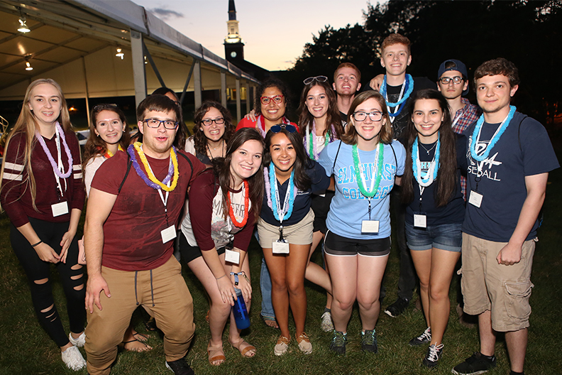 A group of students pose together for a photo on the Elmhurst University campus.