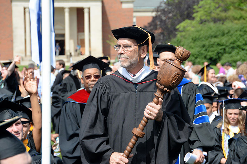 Elmhurst University faculty member Alan Weiger serves as the Faculty Marshal during the University's Commencement ceremonies.