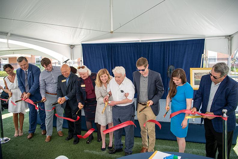 A ribbon-cutting ceremony was held for the dedication of Jean Koplin Memorial Hall at Elmhurst University.