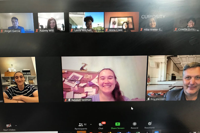 Photo of people appearing on-screen during a virtual event hosted by Elmhurst University.