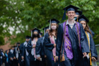 A line of Elmhurst University graduates is seen during the procession into the 2021 Commencement ceremony.