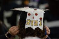 "A student's cap reads ""2021"" at Elmhurst University's 2021 Commencement ceremony."